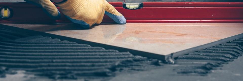Cementos y adhesivos para la colocación de azulejos y cerámica